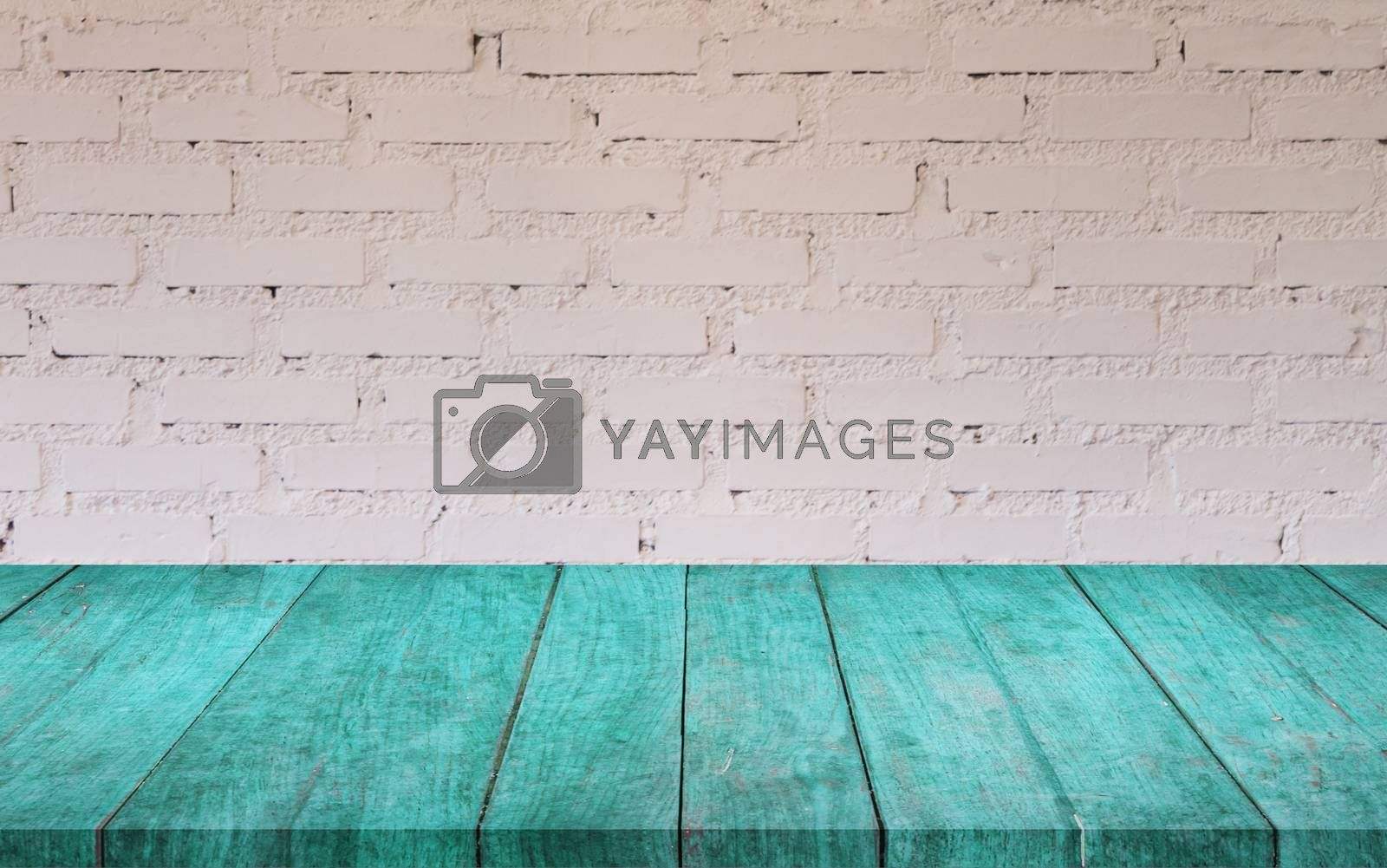 Royalty free image of Blue wooden table top with white brick wall by punsayaporn