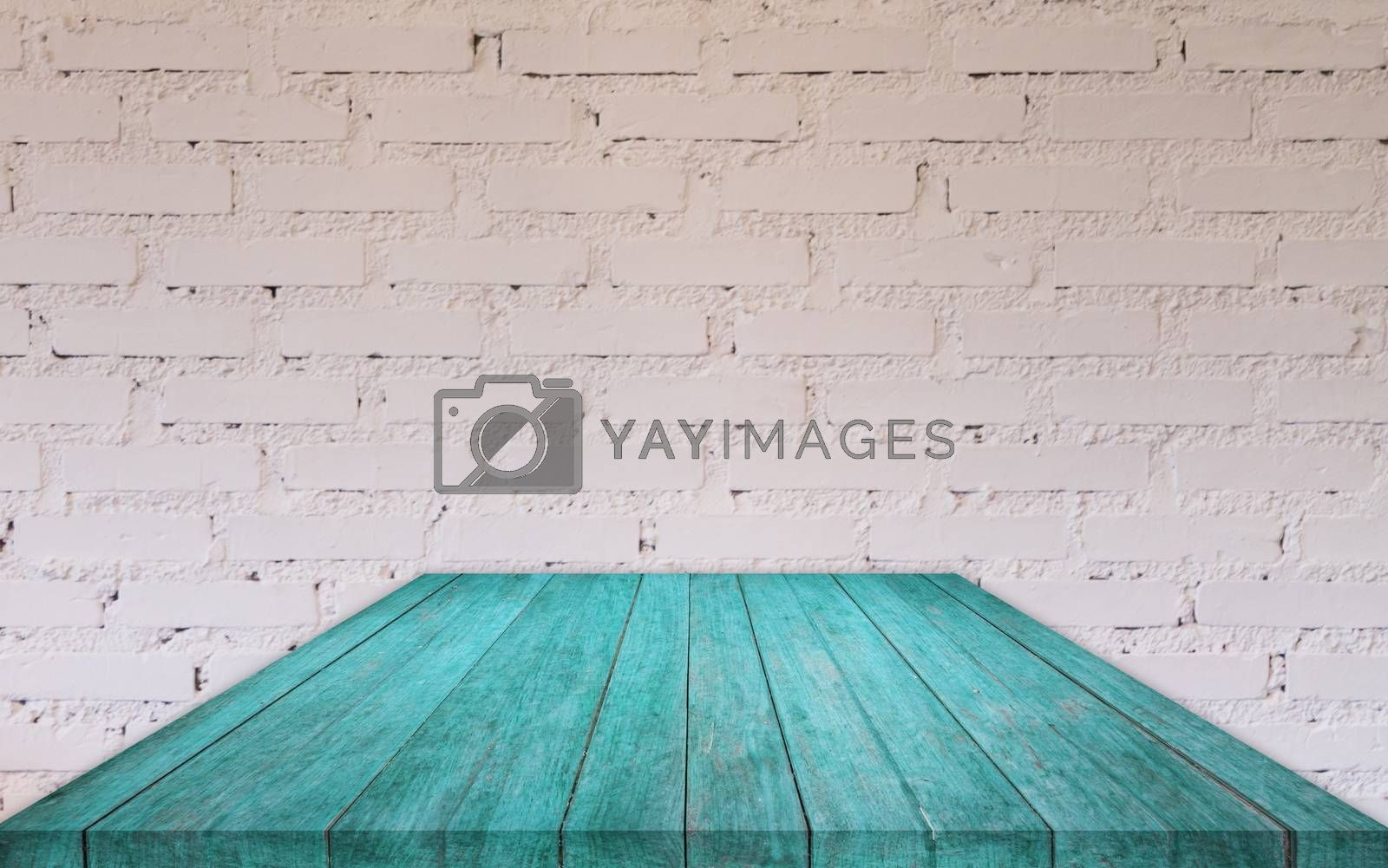 Royalty free image of Perspective blue wooden table top with brick wall by punsayaporn