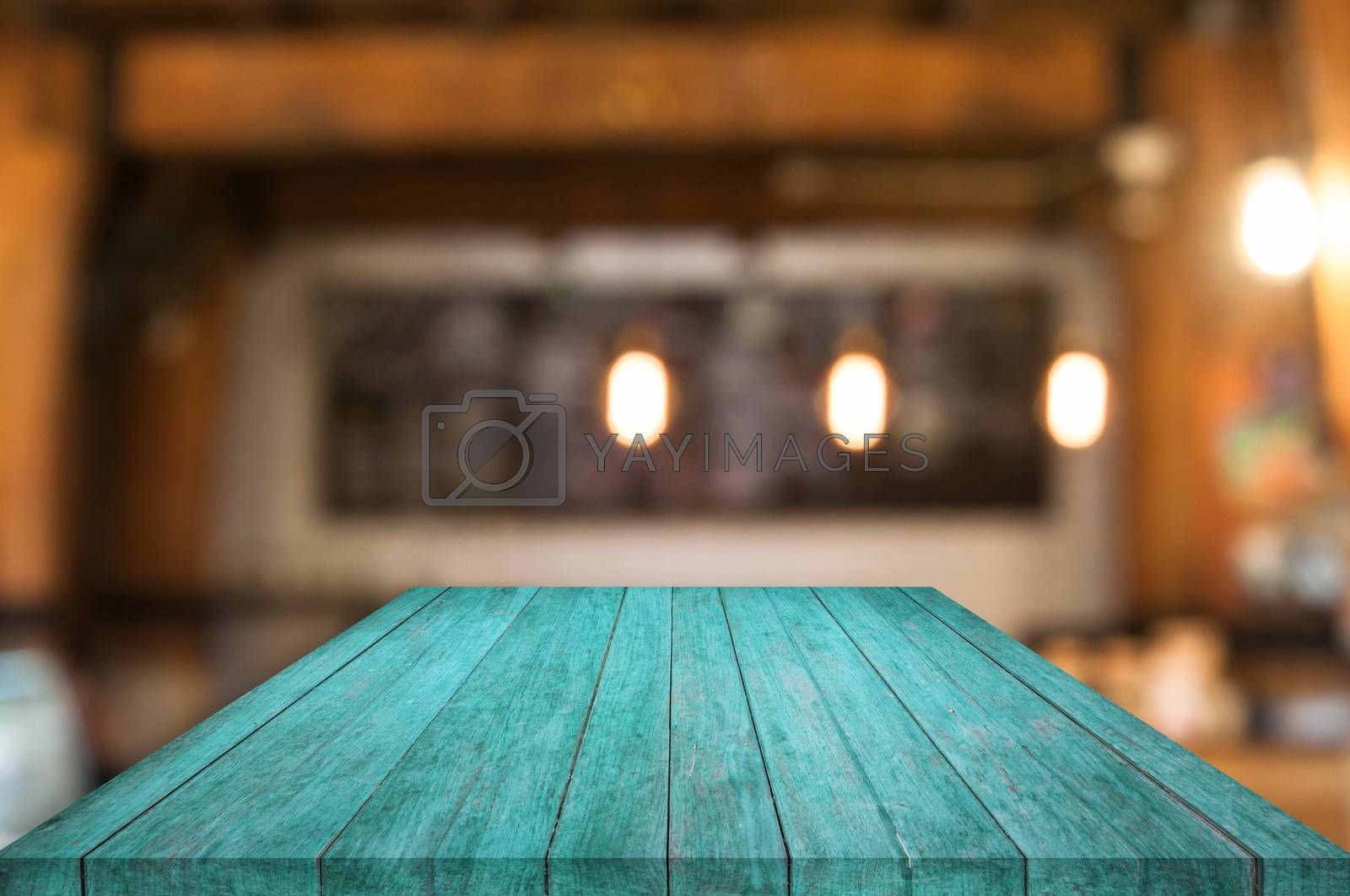 Royalty free image of Perspective blue wooden table top with coffee shop by punsayaporn