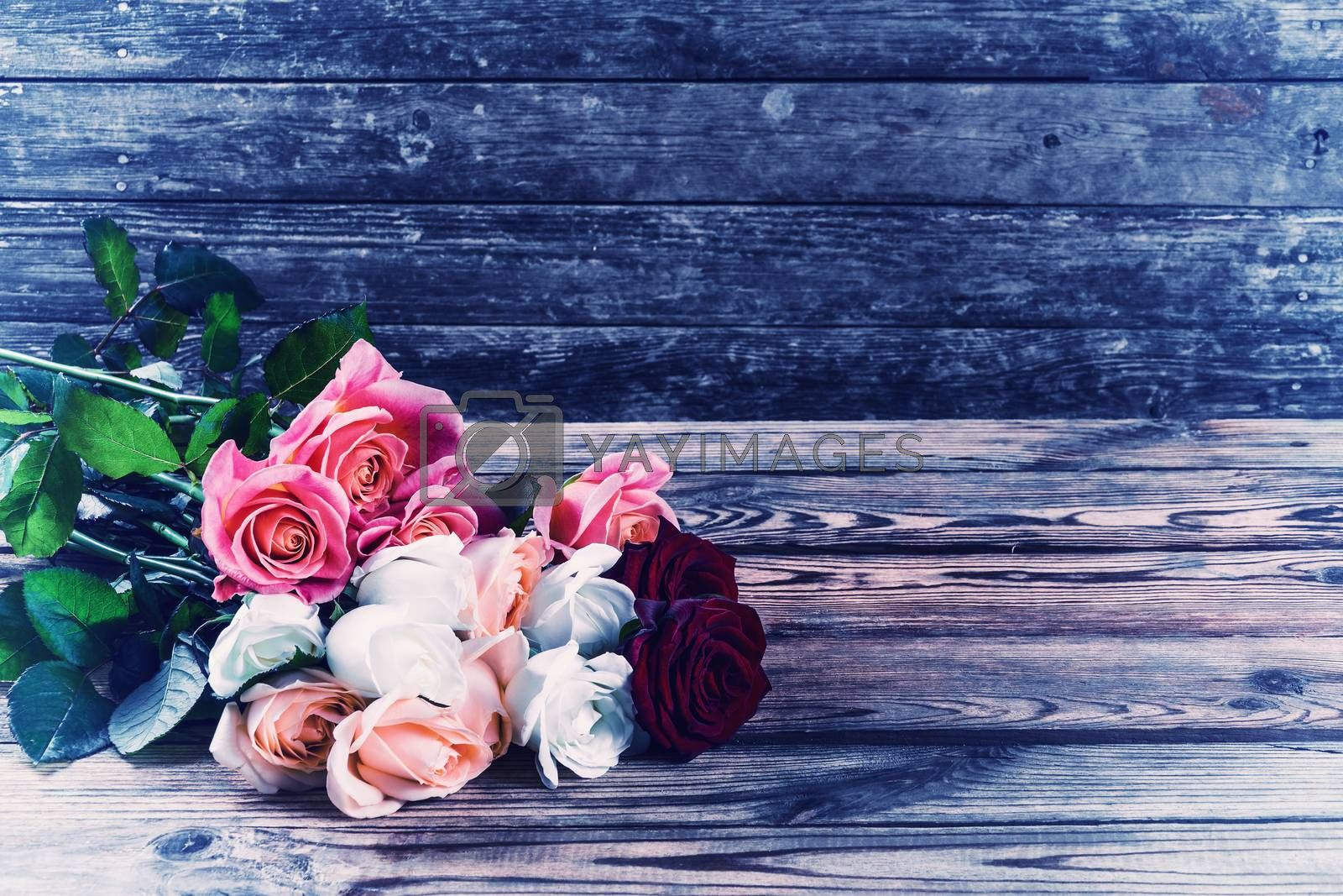 Vintage beautiful bouquet of flowers roses on rustic wooden table