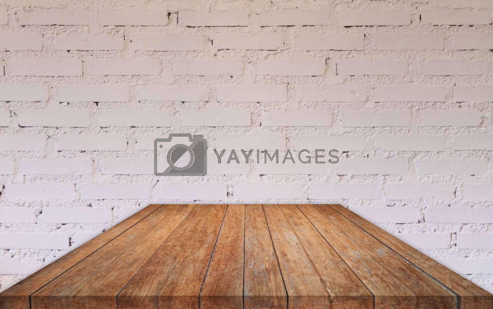 Royalty free image of Perspective wooden table top with brick wall by punsayaporn