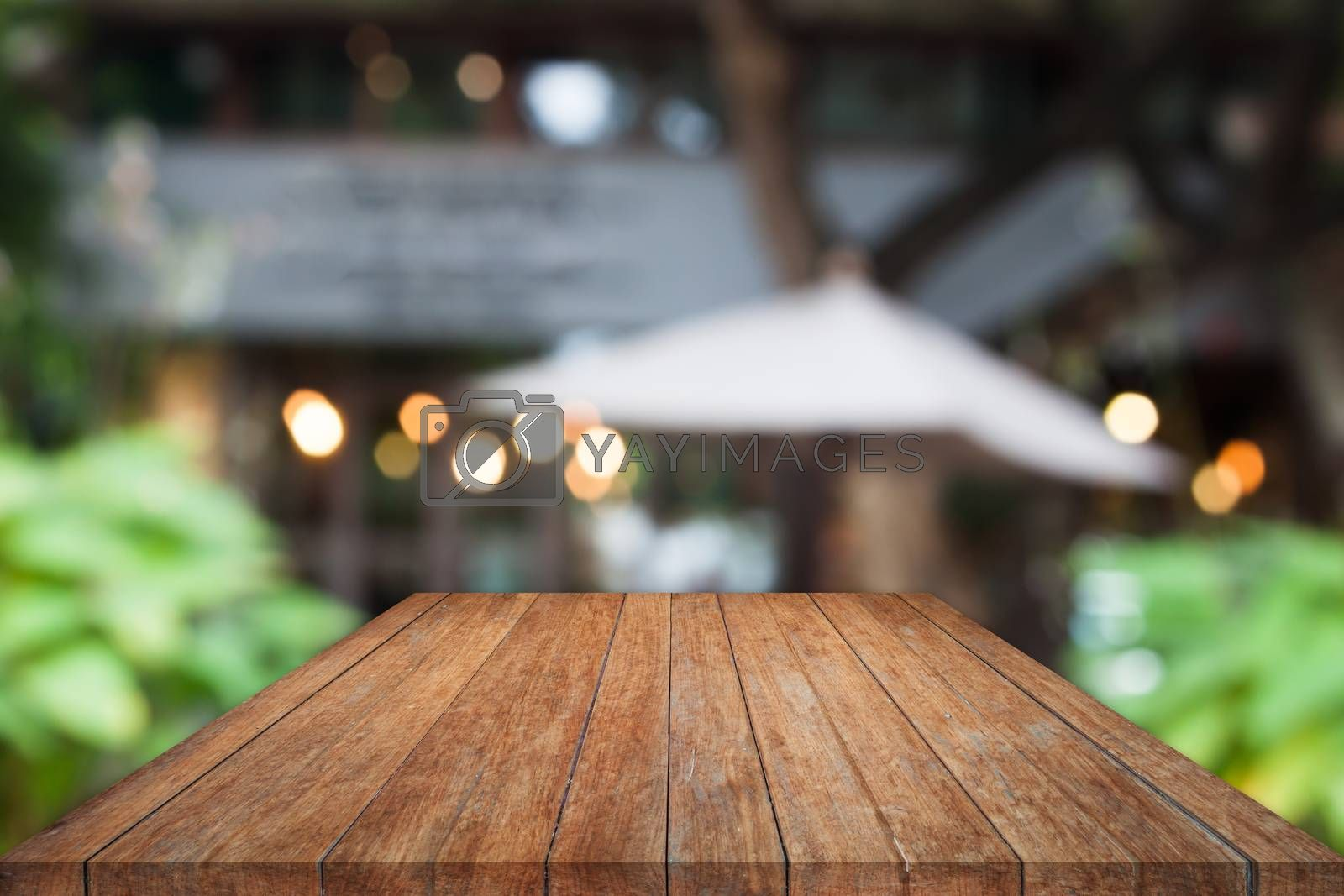 Royalty free image of Perspective wooden table top with cafe background by punsayaporn