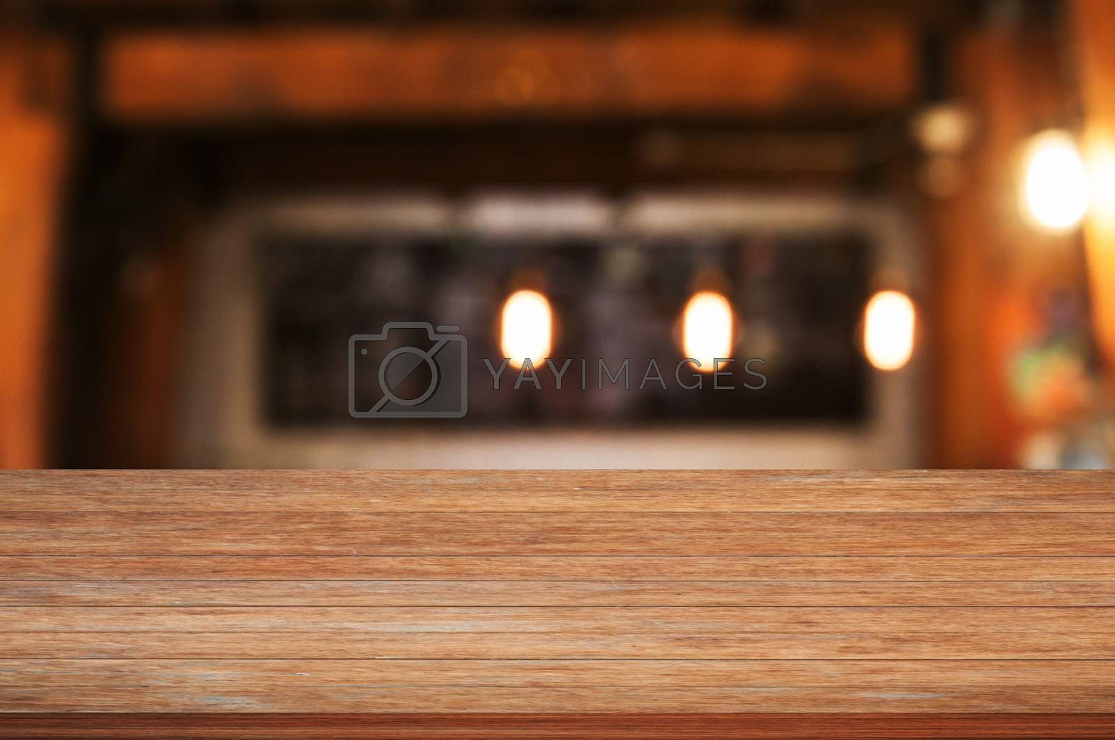 Royalty free image of Top of wooden table top with coffee shop by punsayaporn