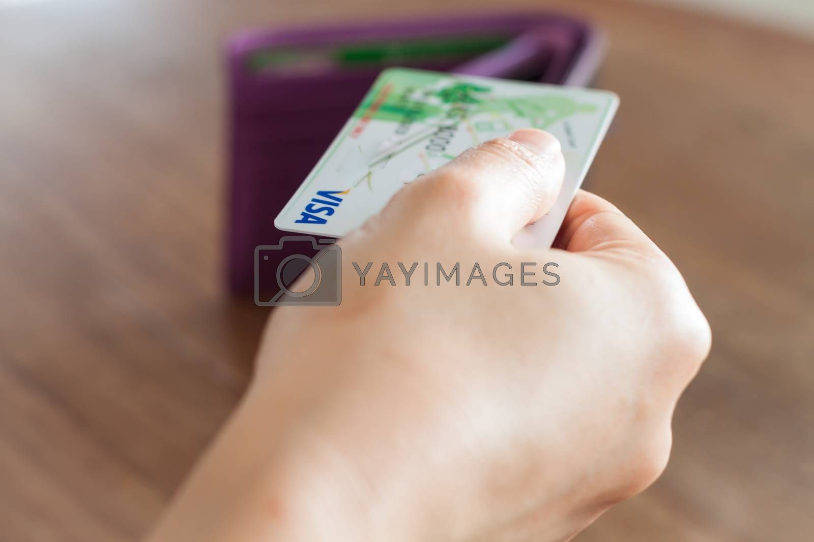 CHIANG RAI, THAILAND - March 3, 2016: Woman's hand holding visa card, stock photo