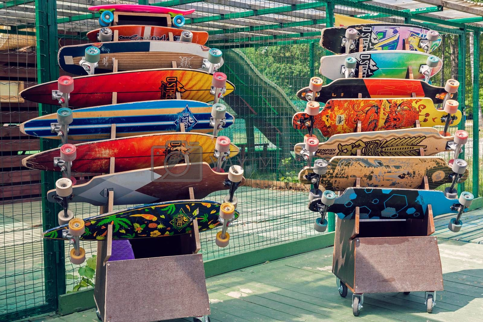 VILNIUS, LITHUANIA - MAY 29, 2016: Colorful longboards and skateboards for rent in skateboarding park outdoors in Vilnius, Lithuania.