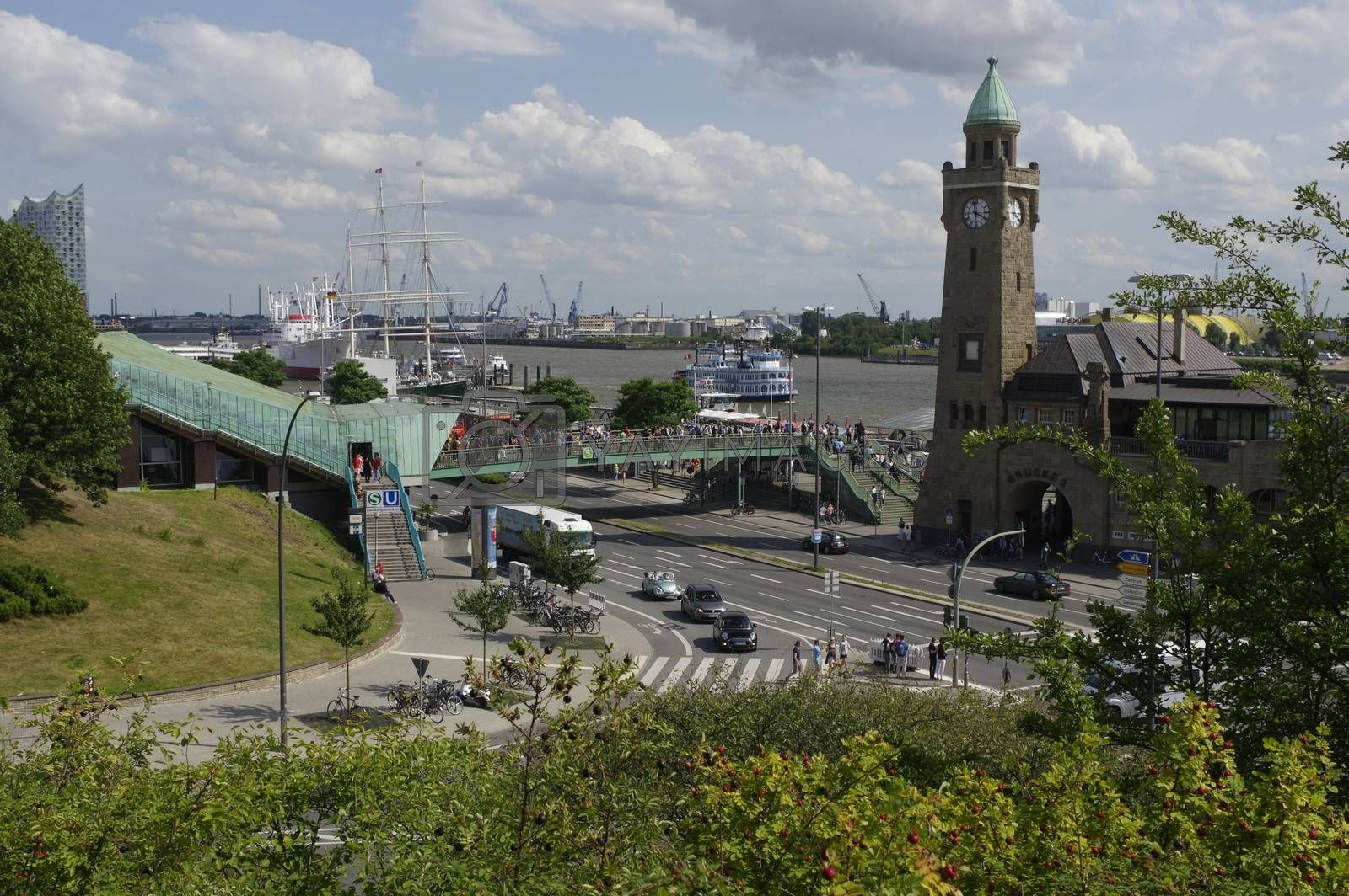 Famous Hamburger Landungsbruecken with harbor and traditional paddle steamer on Elbe river, St Pauli district, Hamburg, Germany