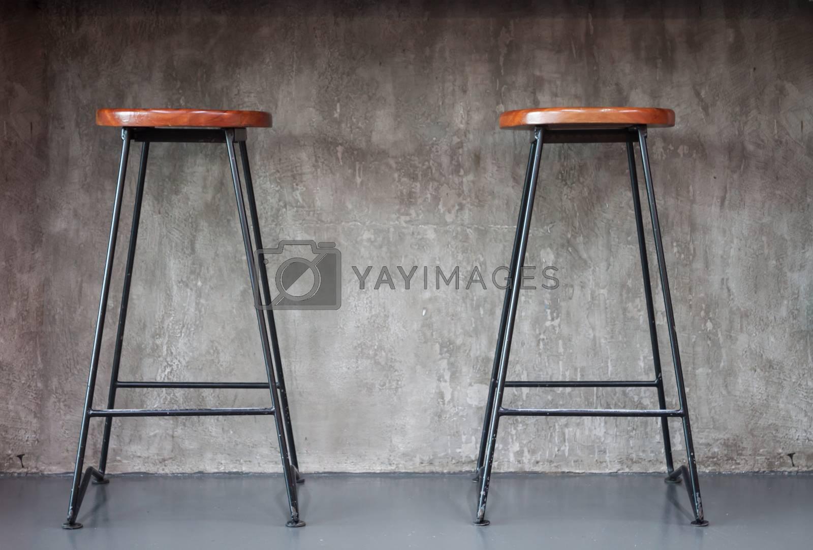 Elegant chairs with empty concrete background, stock photo
