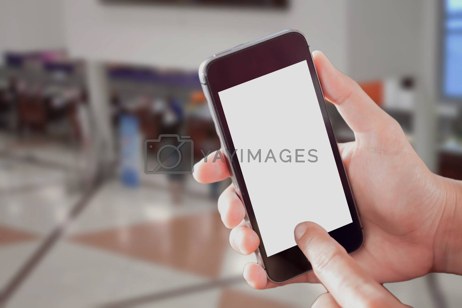 Smart phone with white screen in hand on blurred in airport background