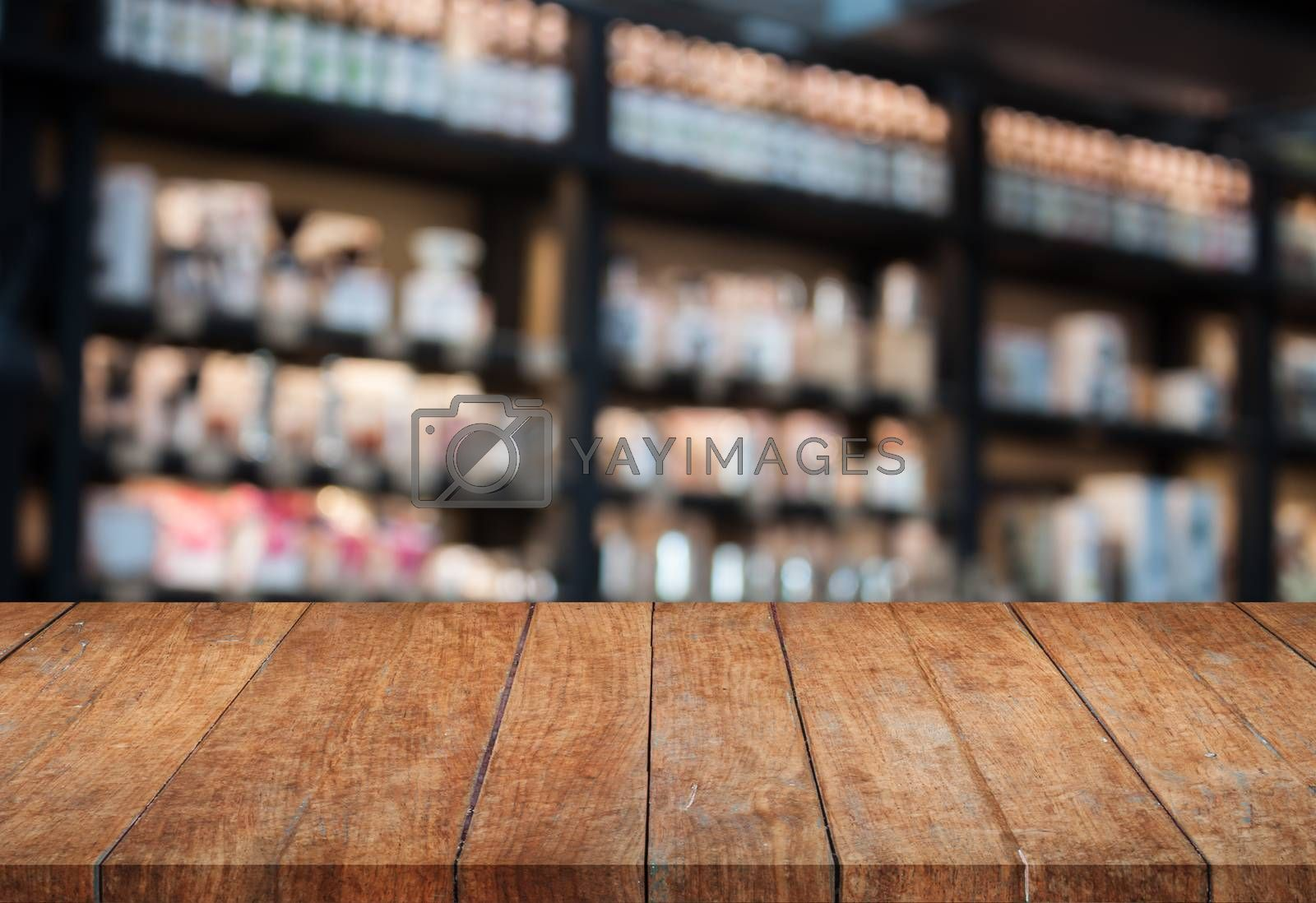 Perspective top wooden table with blurred cafe background. product display template