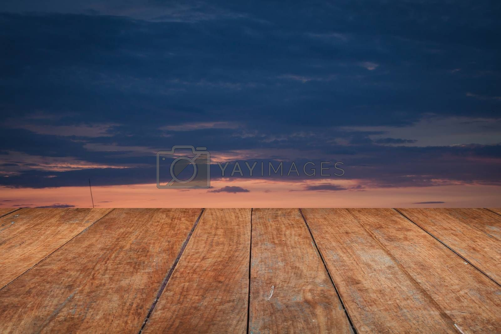 Perspective top wooden with sunrise on the lake with beautiful sky