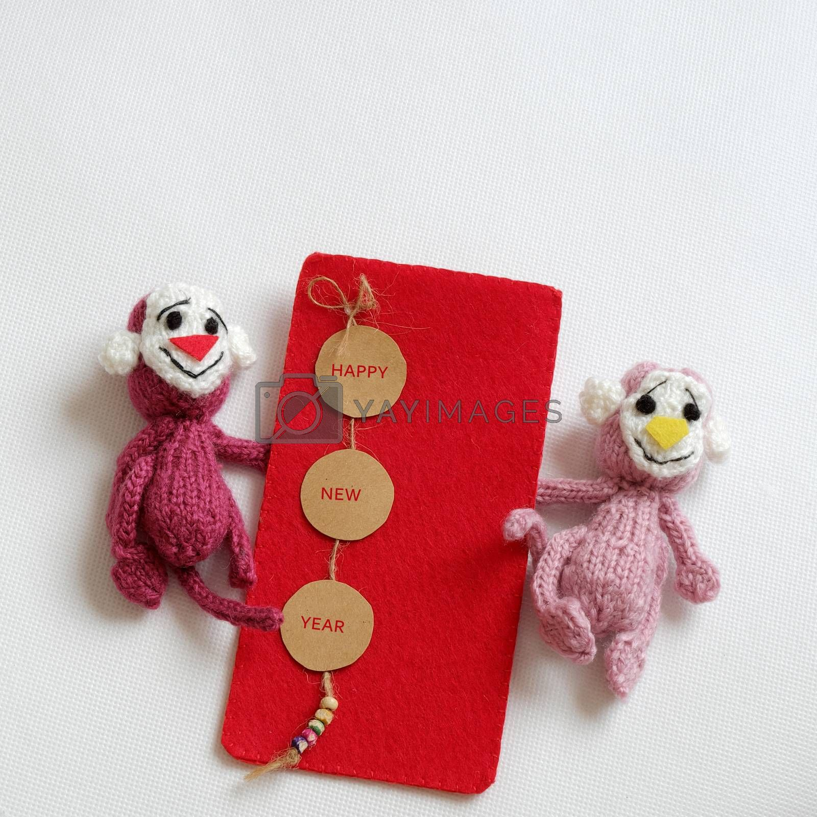 2016, year of monkey, handmade happy new year on white background, knitted monkey, funny stuffed animal, knit flower from yarn, red envelope for lucky money, sign for Vietnam Tet