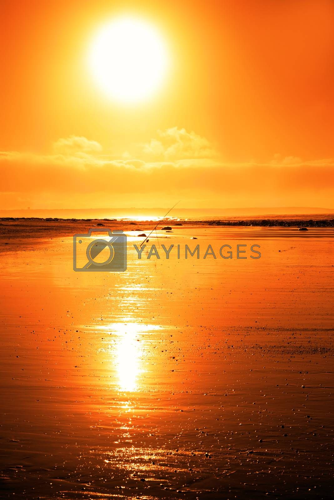 mounted fishing rod on a sunset beach in county Kerry Ireland