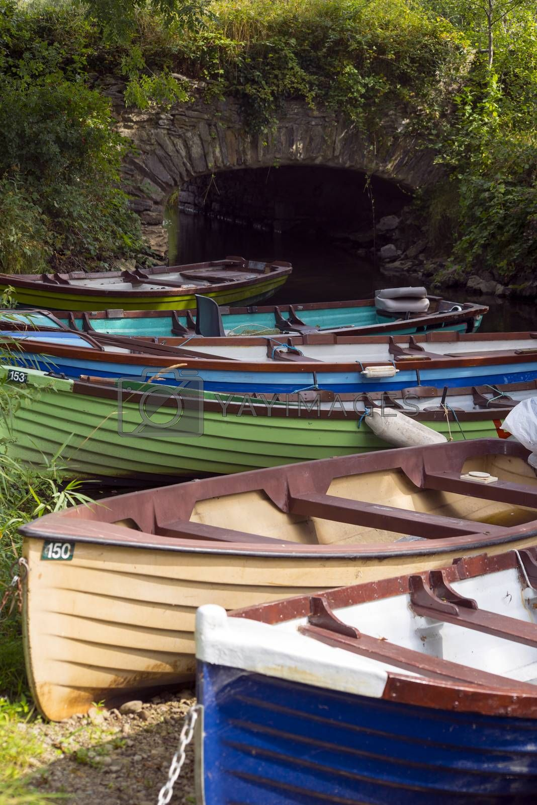 rowing boats moored at ross castle bridge by morrbyte