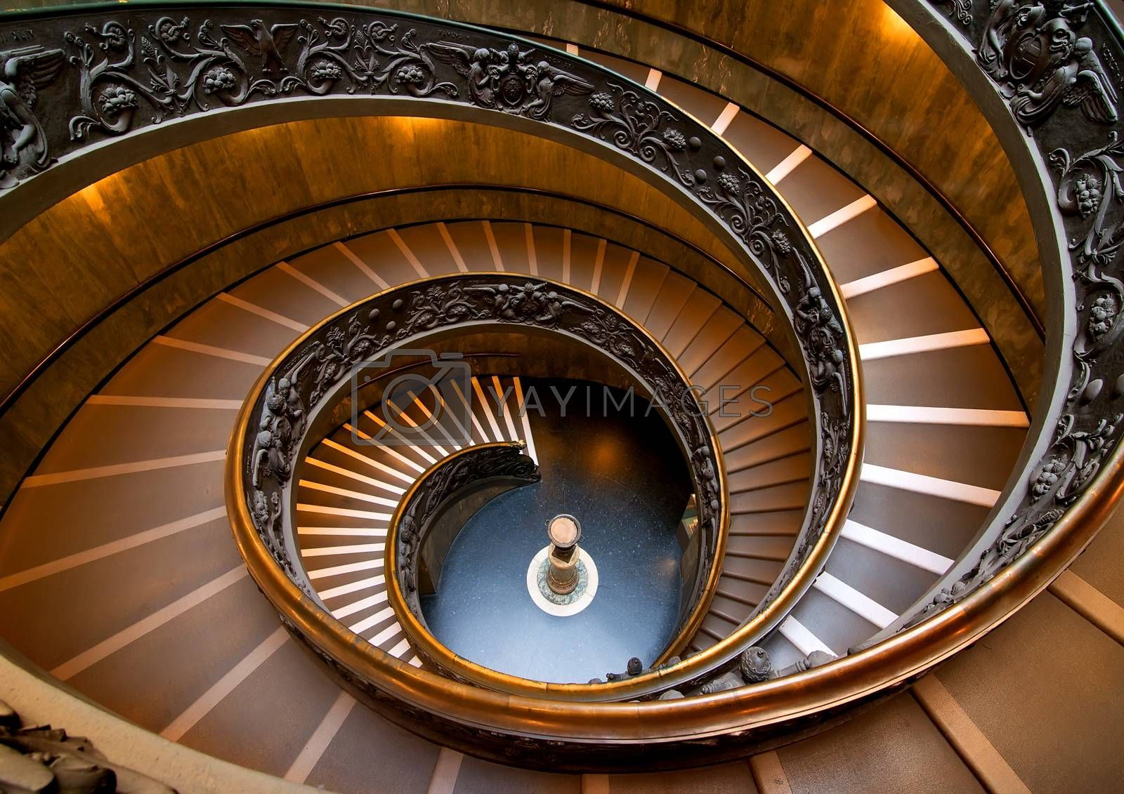 Round staircase in Vatican museum, view from above. Vatican on August 19, ‎2016 in Rome, Italy