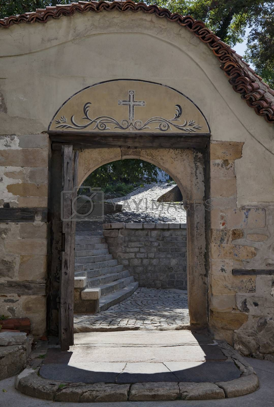 View through a beautiful exit archway of st. The Virgin Mary church in old town Plovdiv, Bulgaria.