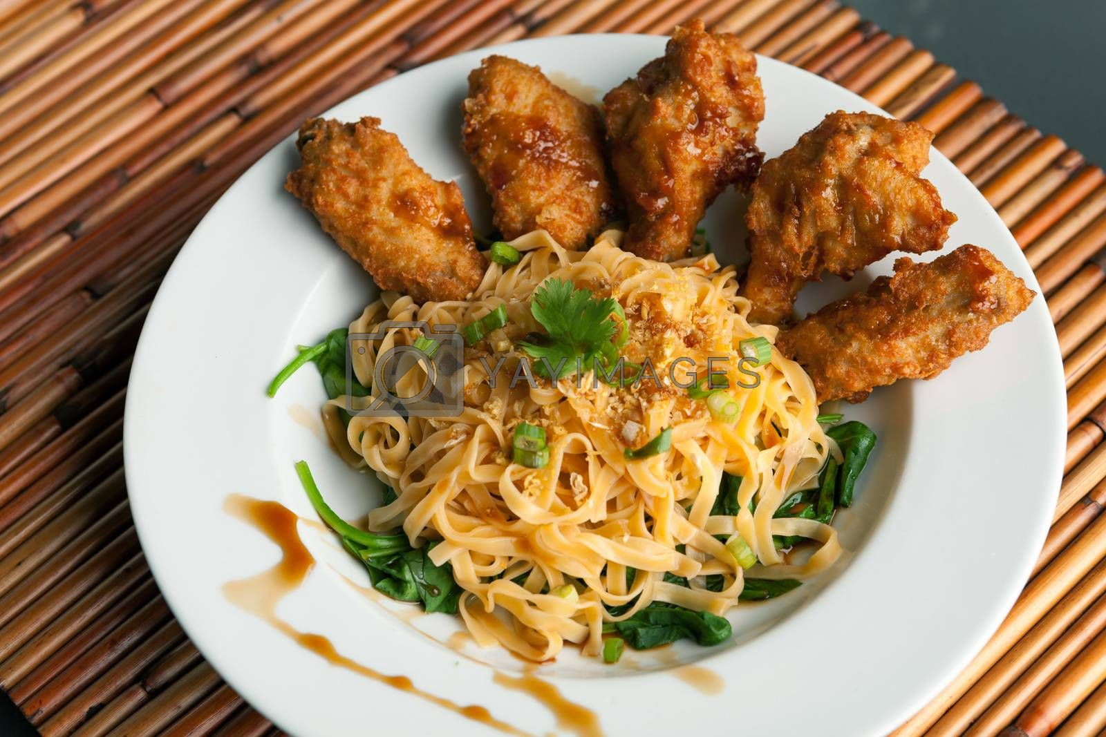 Chicken Wings with Noodles and Spinach by graficallyminded