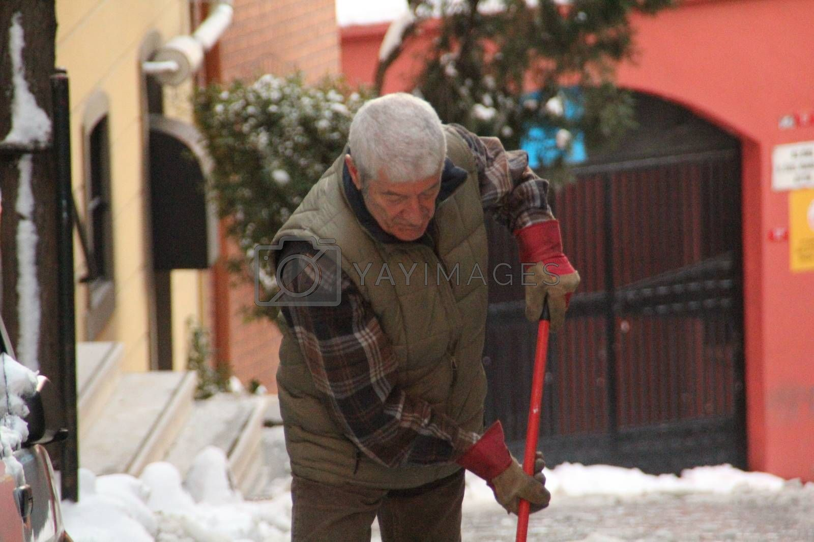 TURKEY, Istanbul: A man shovels as snow blankets Istanbul, Turkey for a third day on January 1, 2016, grounding 529 flights and nearly 30,000 passengers by January 4. Thousands are transferred to hotels, while others are forced to sleep at Sabia Gorken and Ataturk airports. The total cost of the storm has not yet been released.