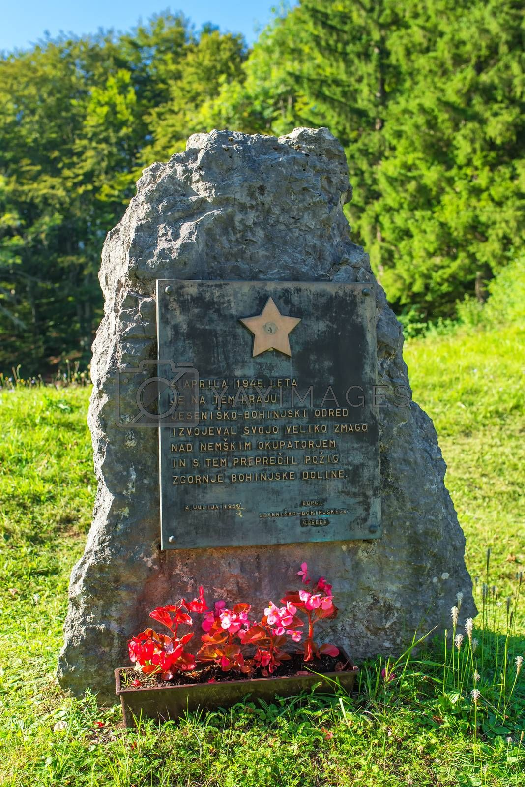 RIBCEV LAZ, SLOVENIA - AUGUST 25, 2016: Memorail stone monument to the Slovenian Partisans from WWII, in Ribcev laz on Bohinj lake