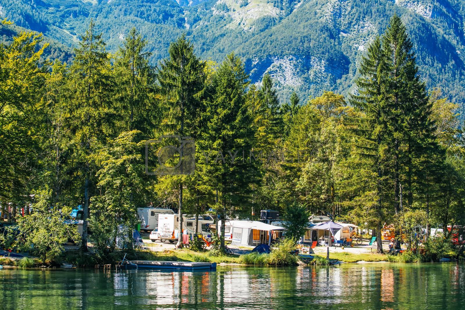 UKANC, SLOVENIA - AUGUST 24, 2016: Ukanc camping site on Bohinj lake in Slovenian national park Triglav.
