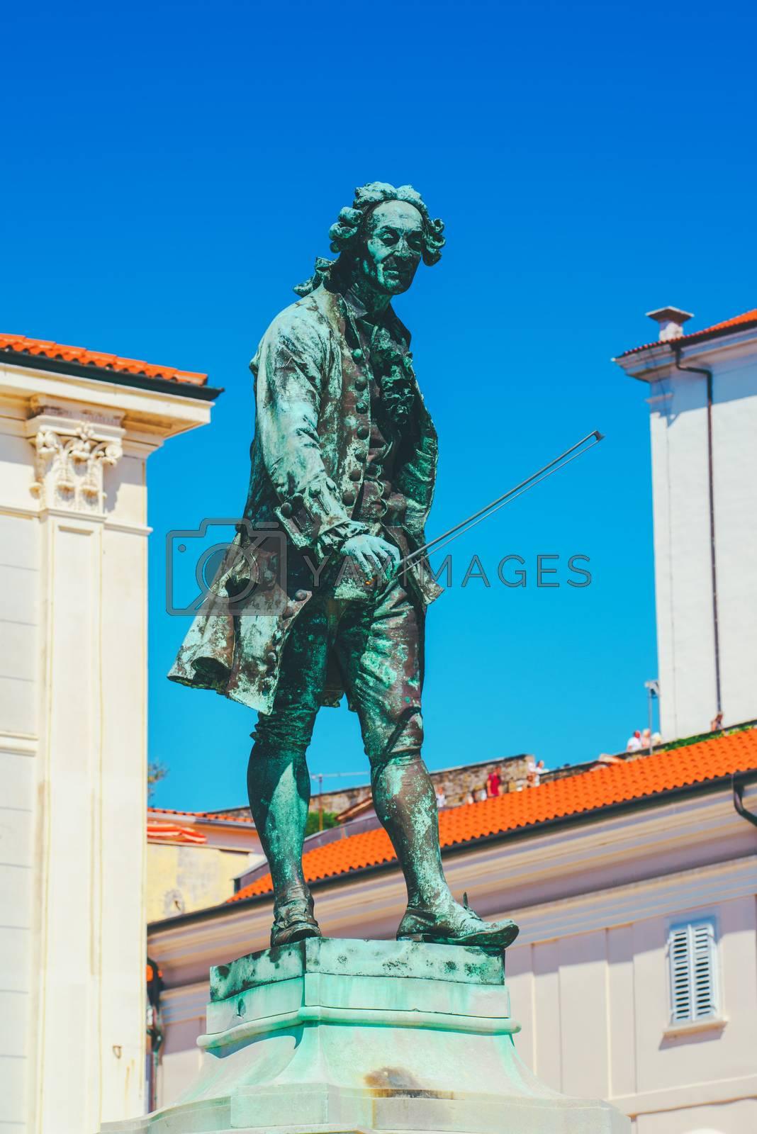 PIRAN, SLOVENIA - AUGUST 27, 2016: Statue of violinist and composer Giuseppe Tartini on the Tartini Square in Piran, Slovenia