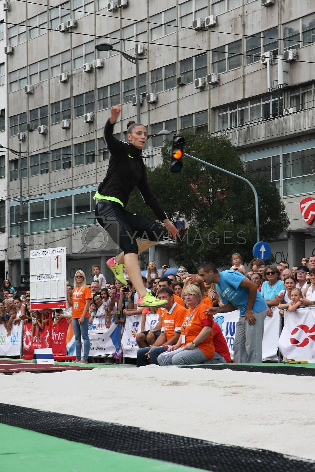 BELGRADE,SERBIA - SEPTEMBER 11 , 2016: Ivana Spanovic testing long jump runway for competition as promotion of European athletics indoors championship which will be held from 3-5.March ,2017 in Belgrade,Serbia