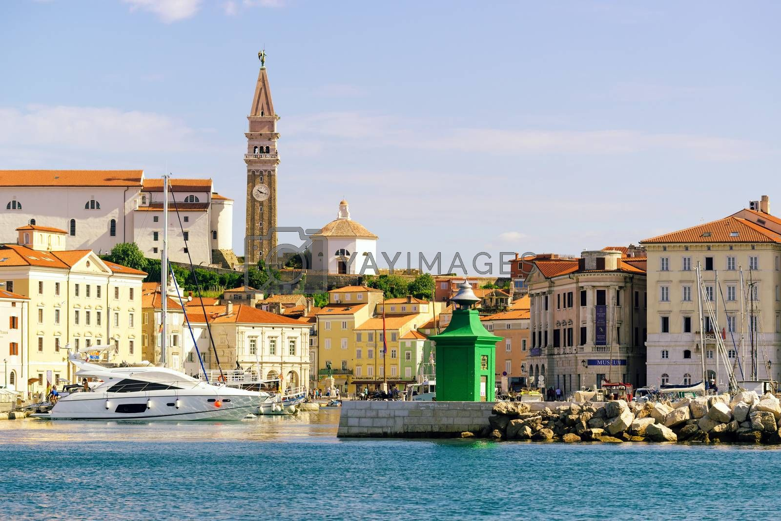 PIRAN, SLOVENIA - AUGUST 30, 2016: Piran marina with fishing boats and old town in background, one of major tourist attractions on Slovenia's Adriatic coast
