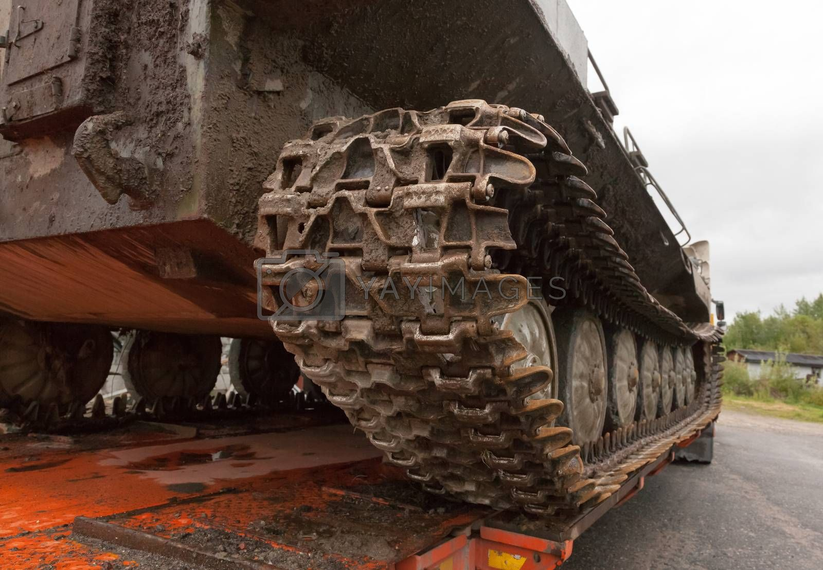 The tracked vehicle pulled into the trawl for transportation to a destination