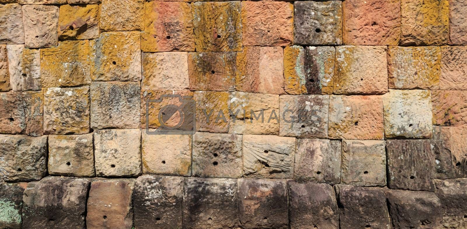 Ancient old and dirty big brick wall inside public temple in Thailand