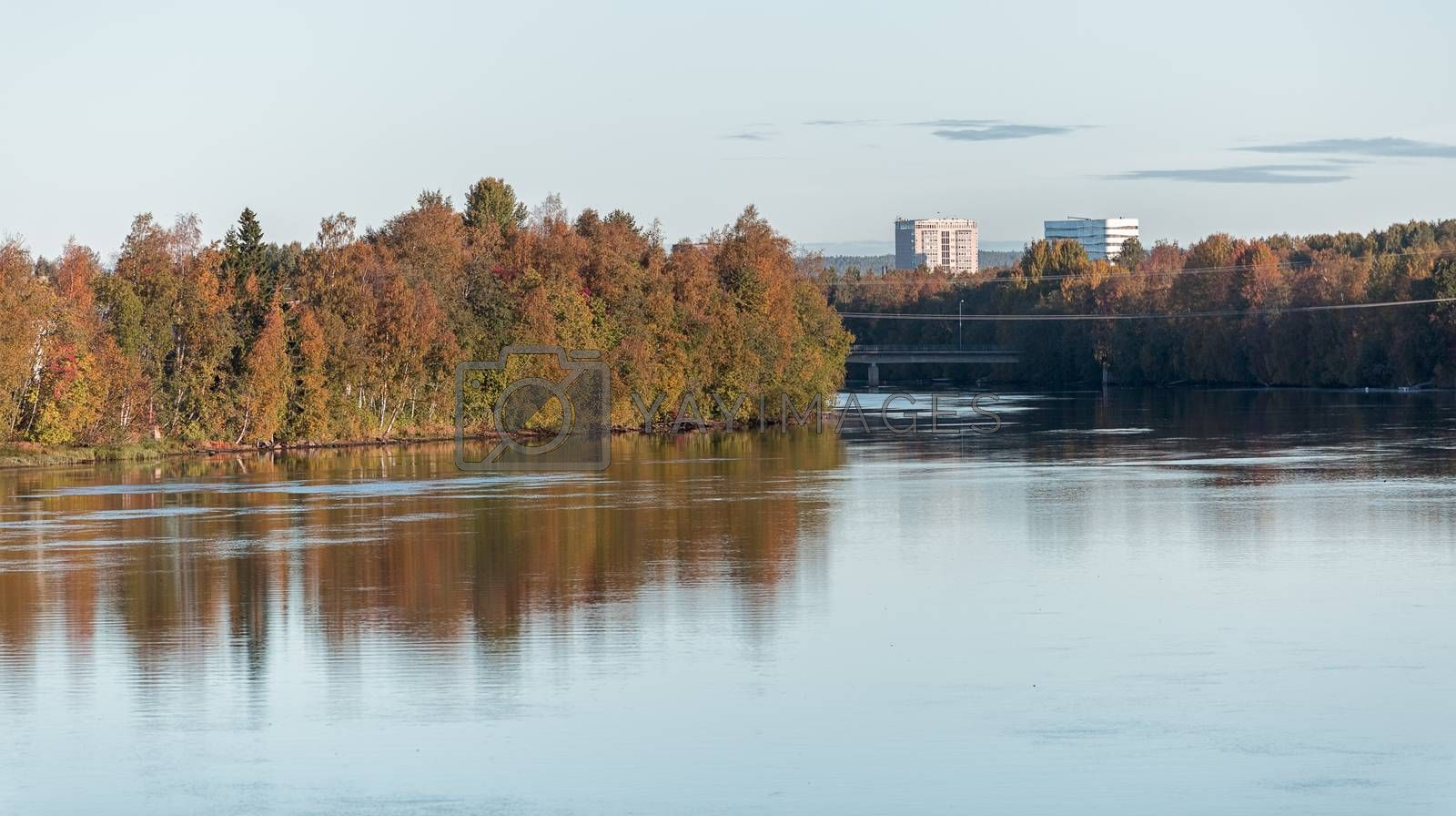 Umea, Sweden and its River in Fall with pair of buildings.