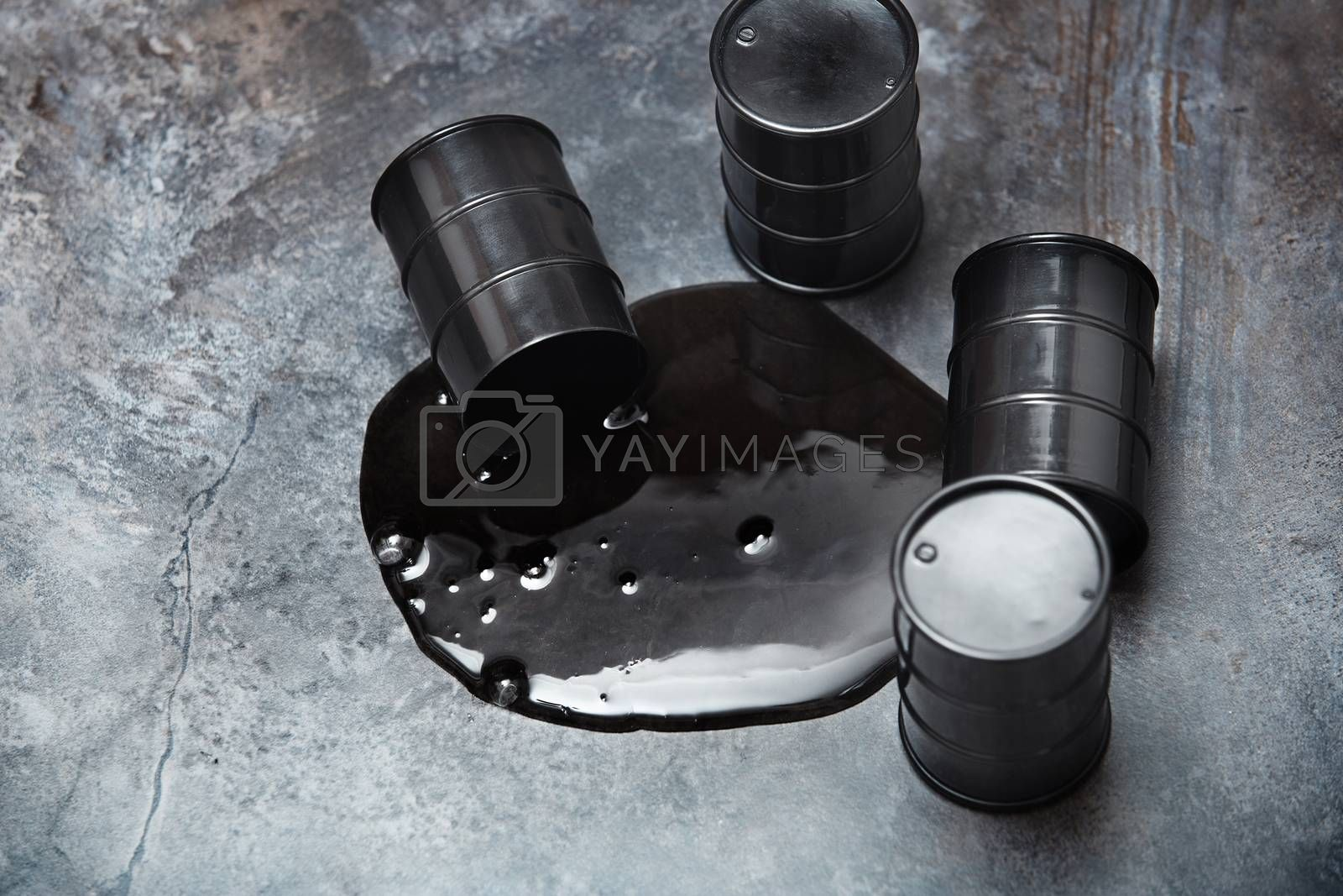 High angle view on four fuel drums with spilled oil