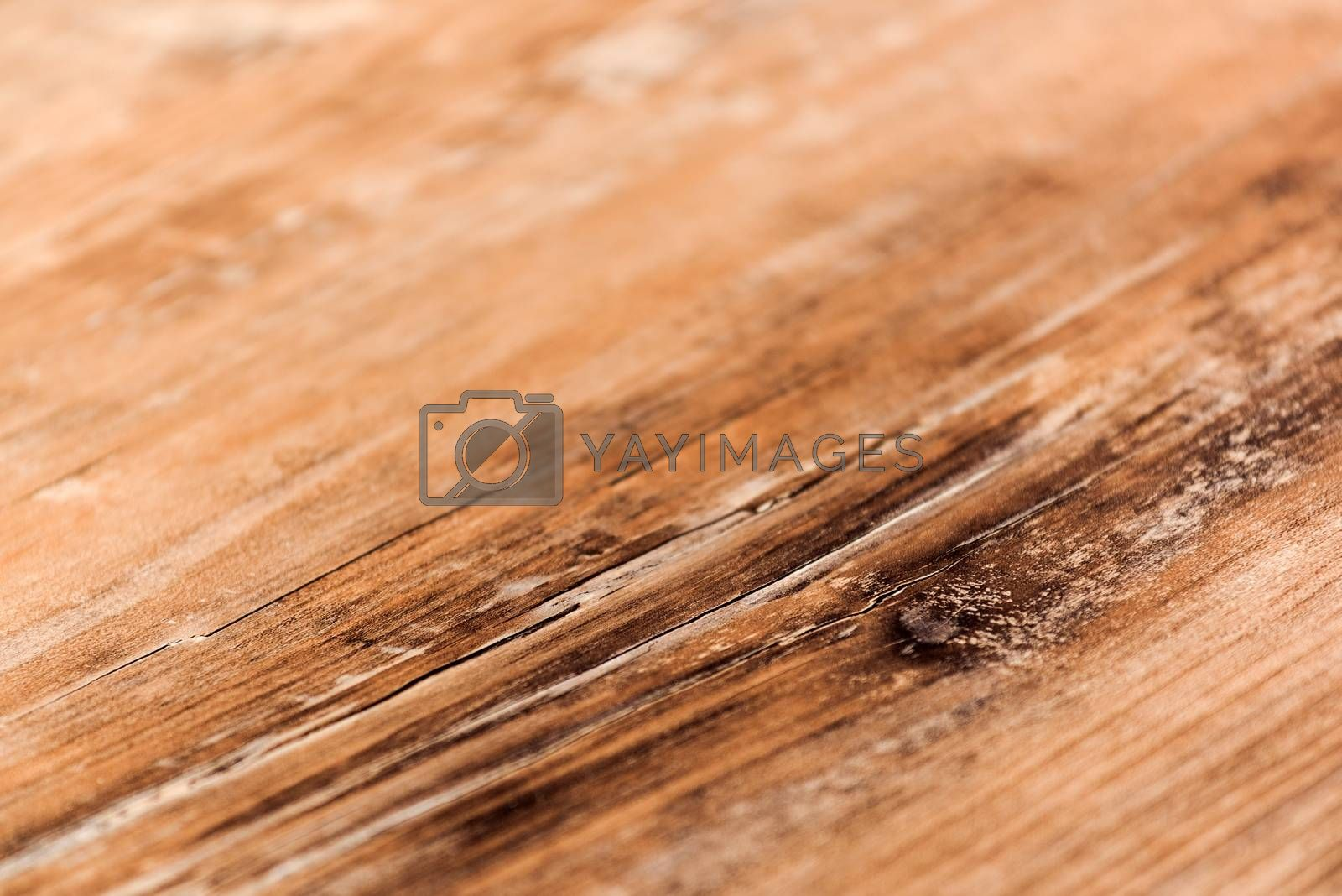 Wooden board as abstract background, close up with shallow depth of field, selective focus