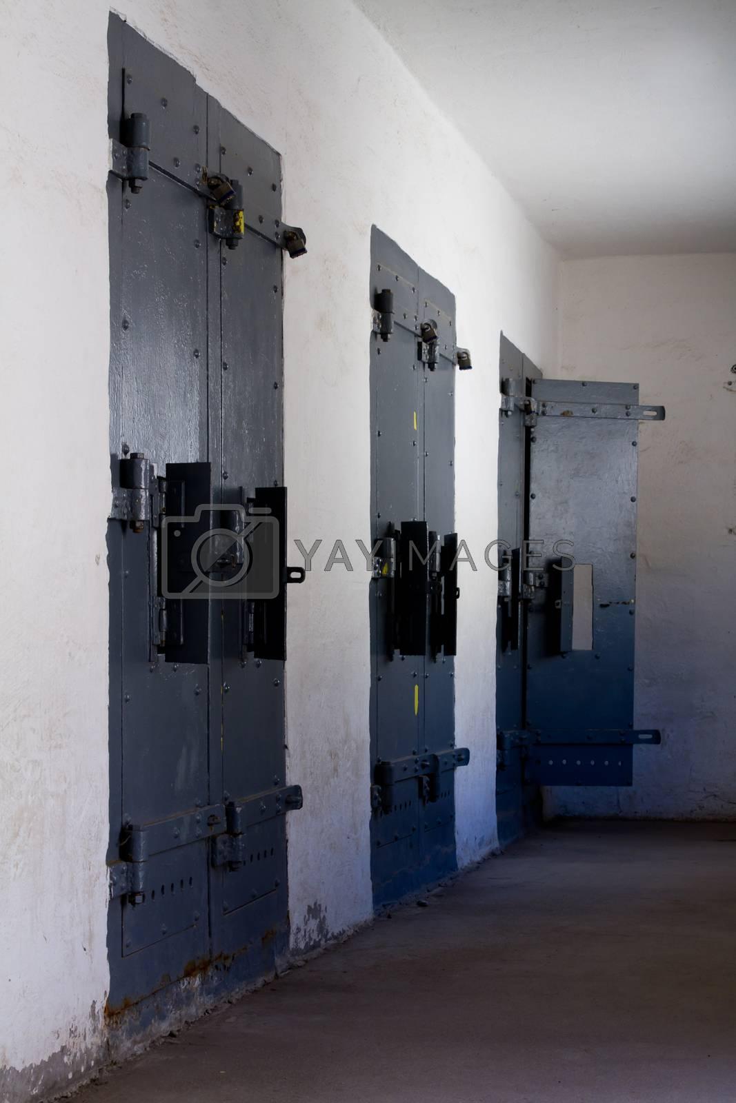 Three doors leading to solitary. Last door of the three is open