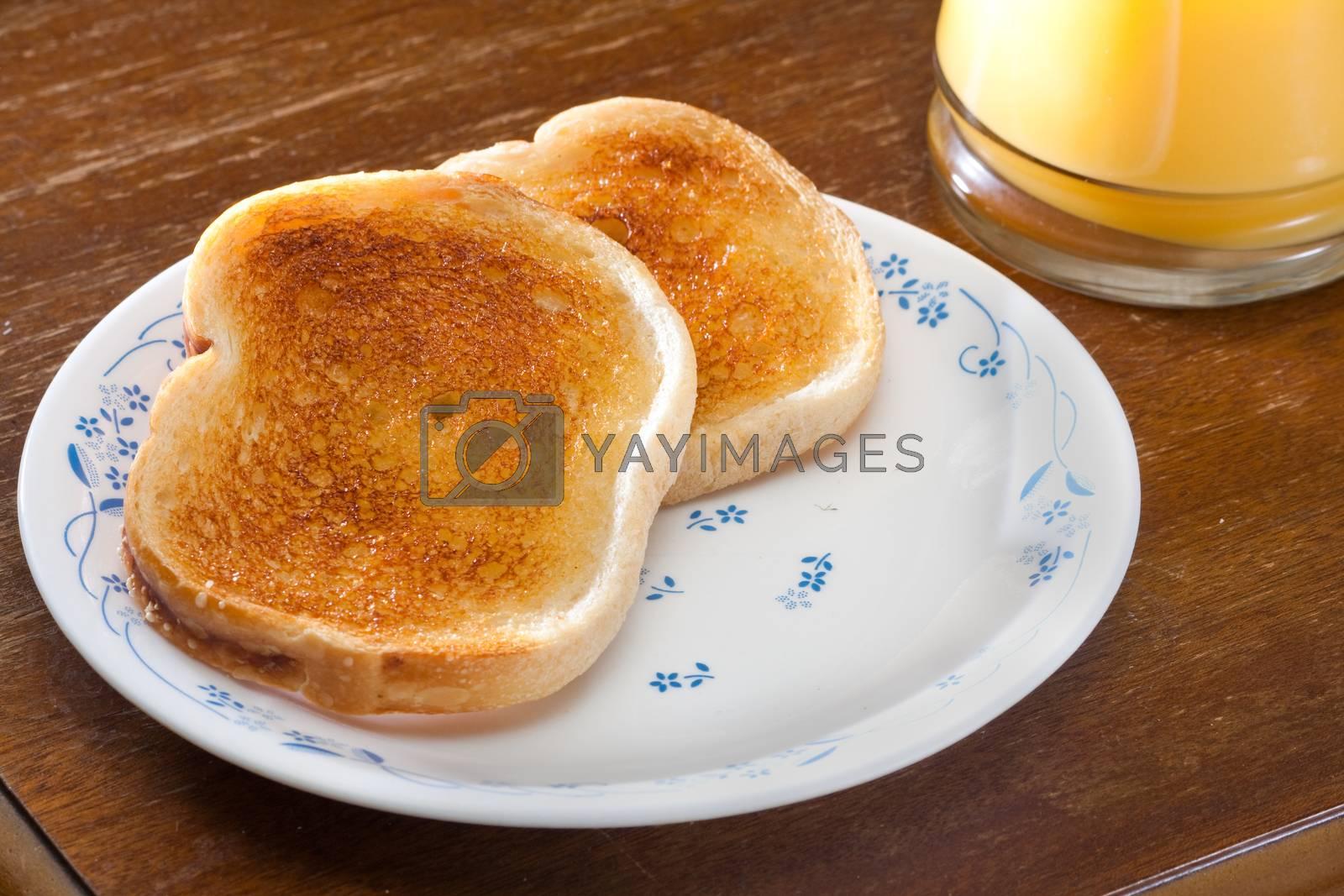 Nice breakfast of toast and orange juice ready to eat