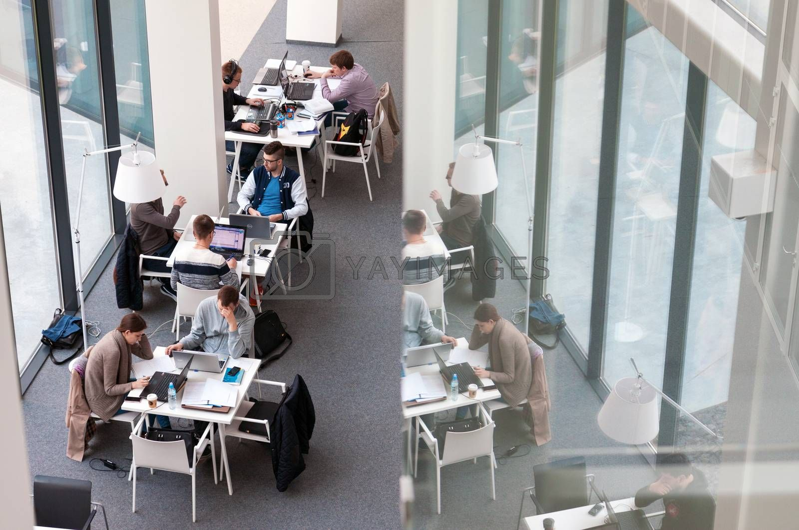 VILNIUS, LITHUANIA - APRIL 23, 2016: Students sitting and studying at Vilnius University library, Lithuania