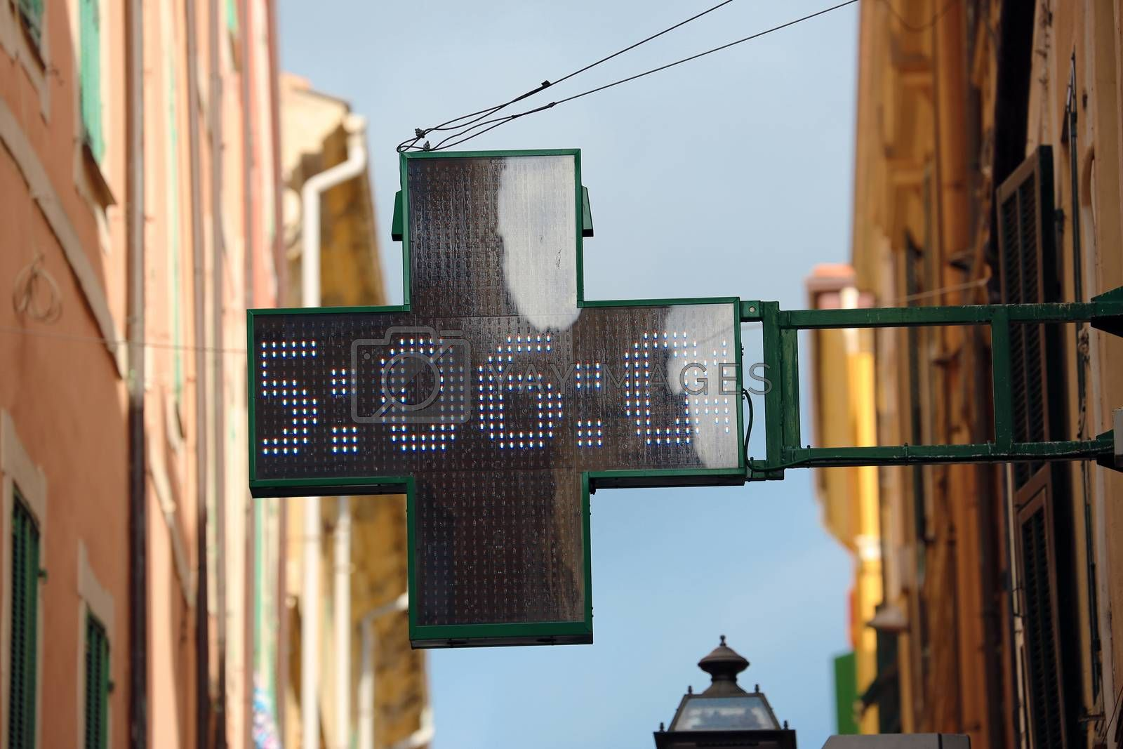Neon Pharmacy Sign with the Time 5:06 in Italia