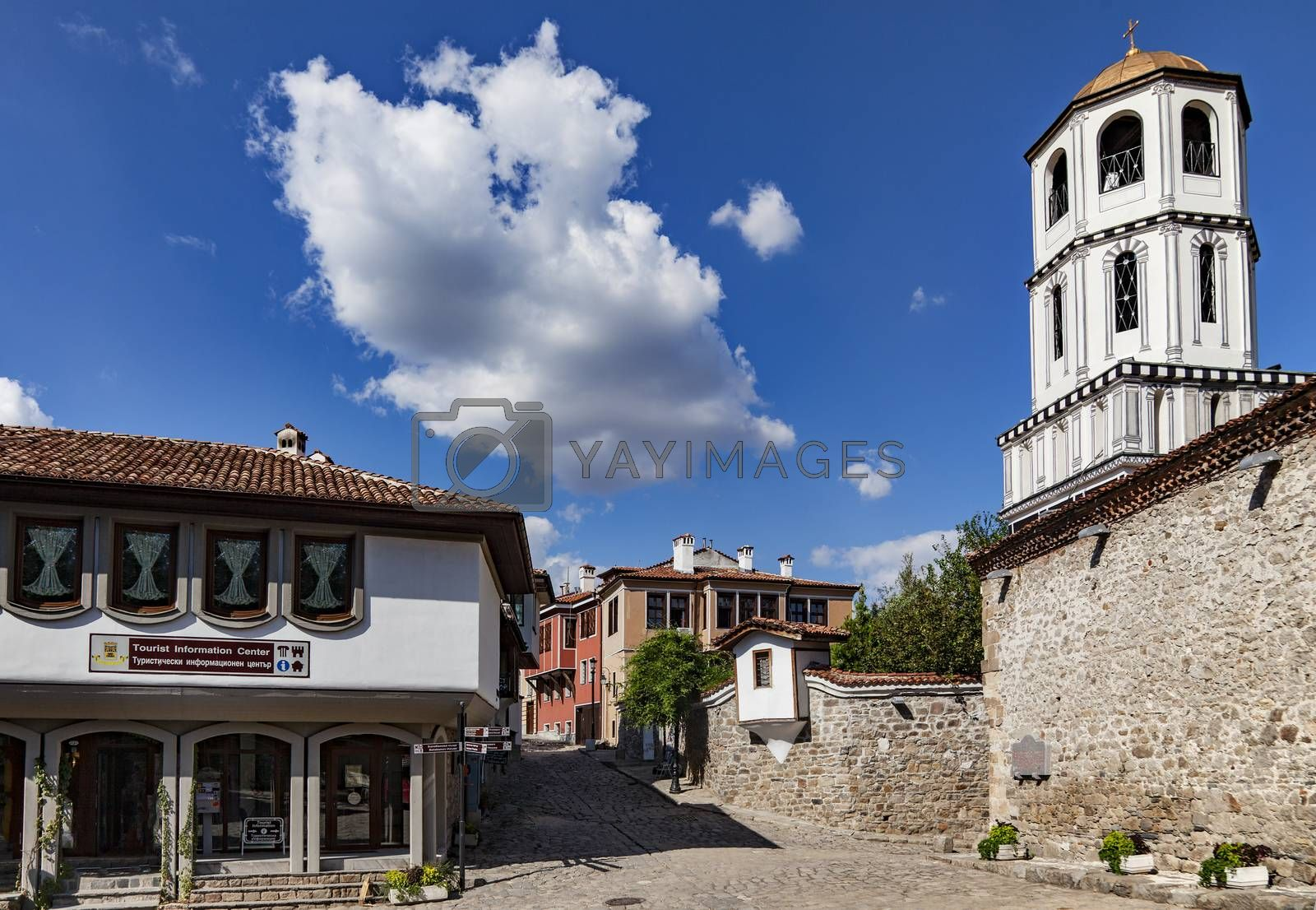 A view of one of the main streets in old town of Plovdiv, Bulgaria with the dome of St. St. Constantine and Helena church