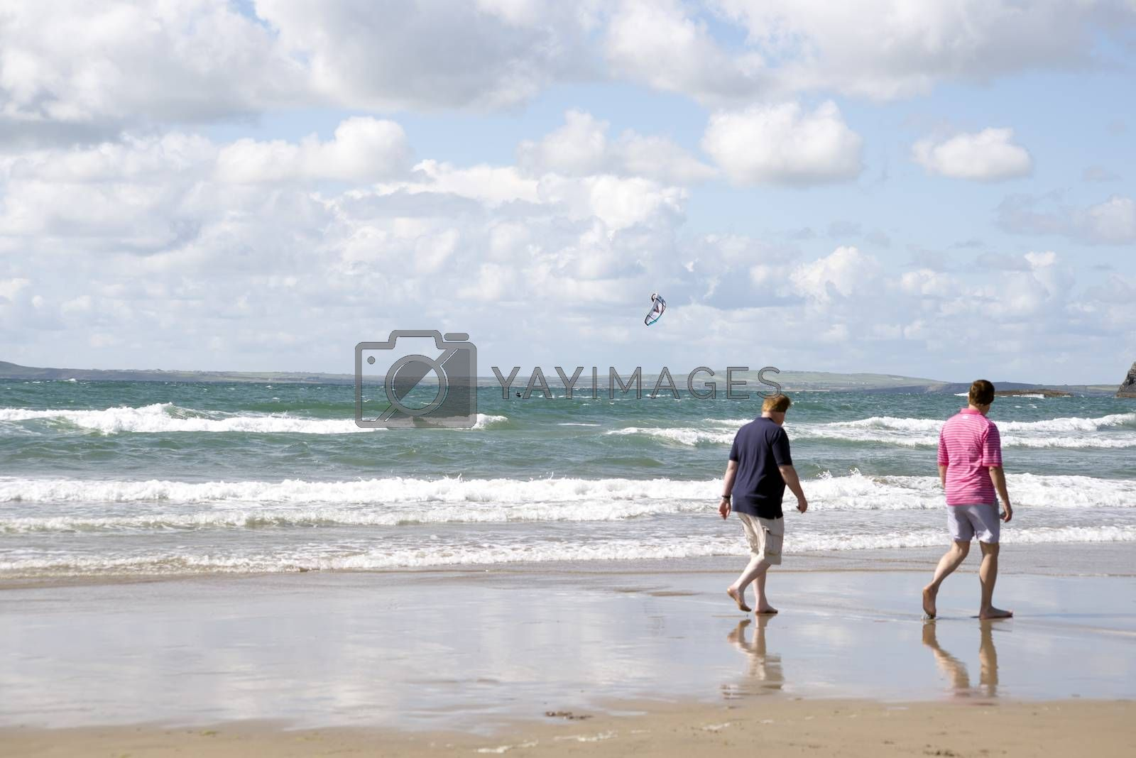 tourists watching kite surfer on beautiful waves at beach in ballybunion county kerry ireland on the wild atlantic way