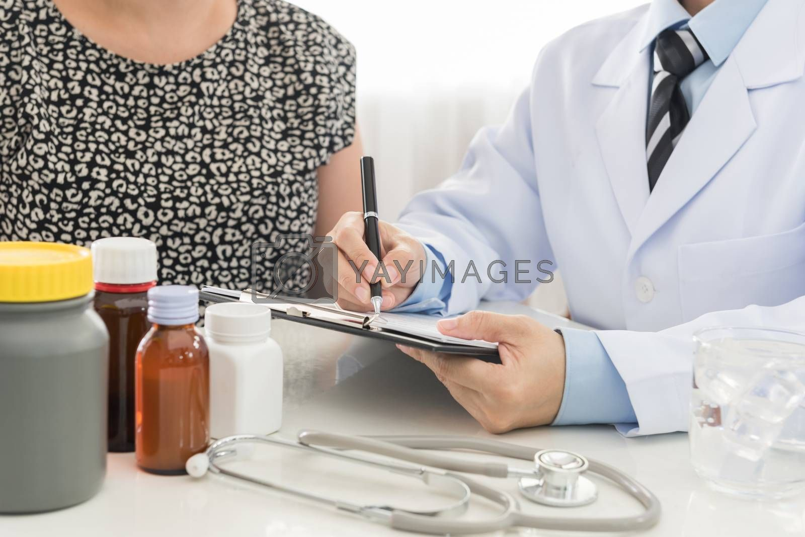 Doctors are recording information the patient's illness.