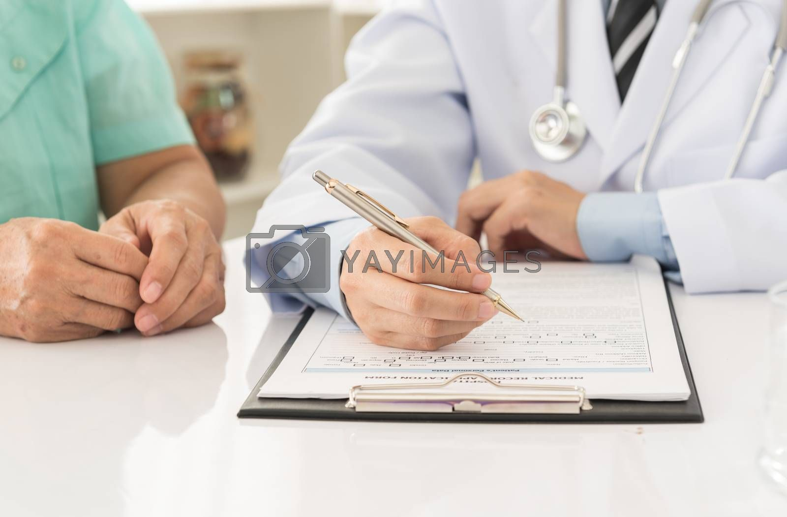 doctor record data on application form while consulting patient