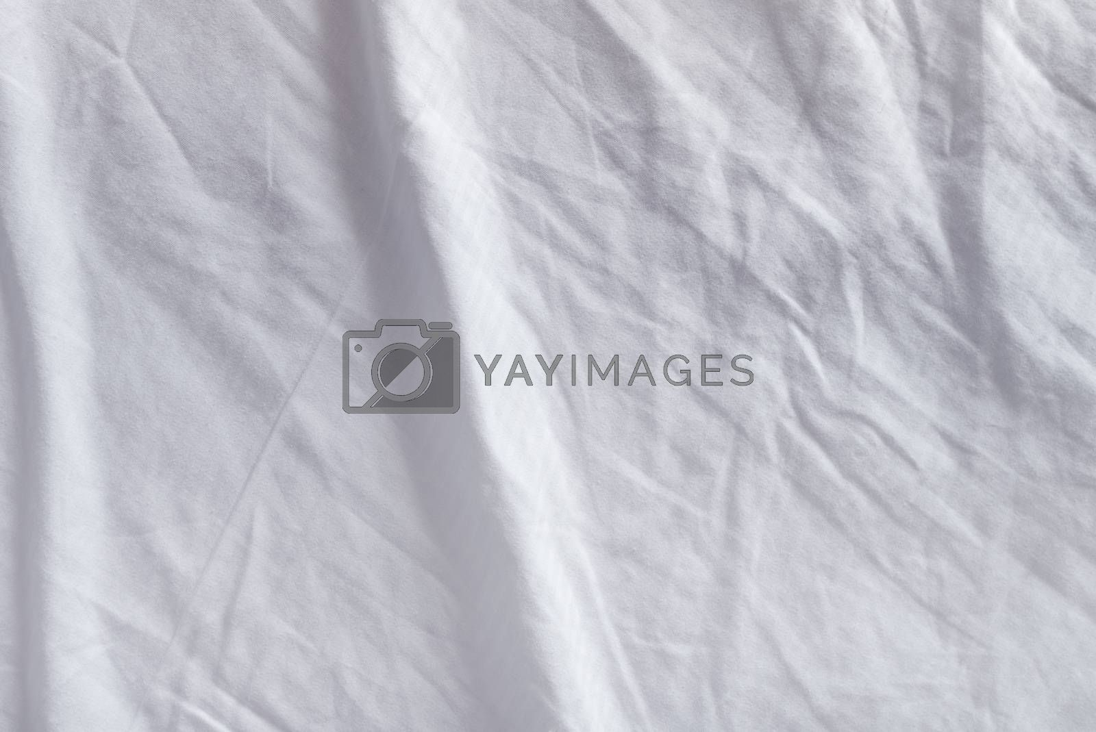 Crumpled bedding texture, top view of used bed sheets