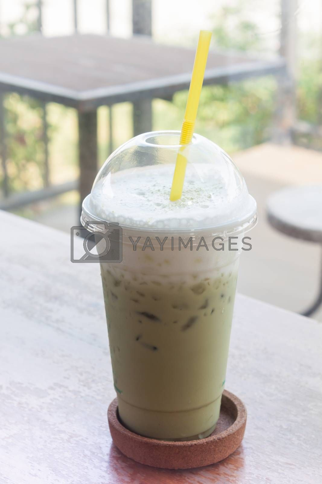 Iced green tea on wooden table, stock photo
