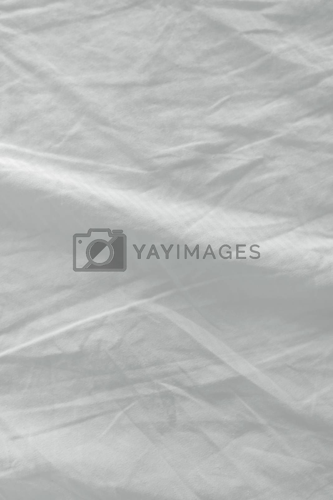 Used bed sheets texture, clean white crumpled cotton material surface
