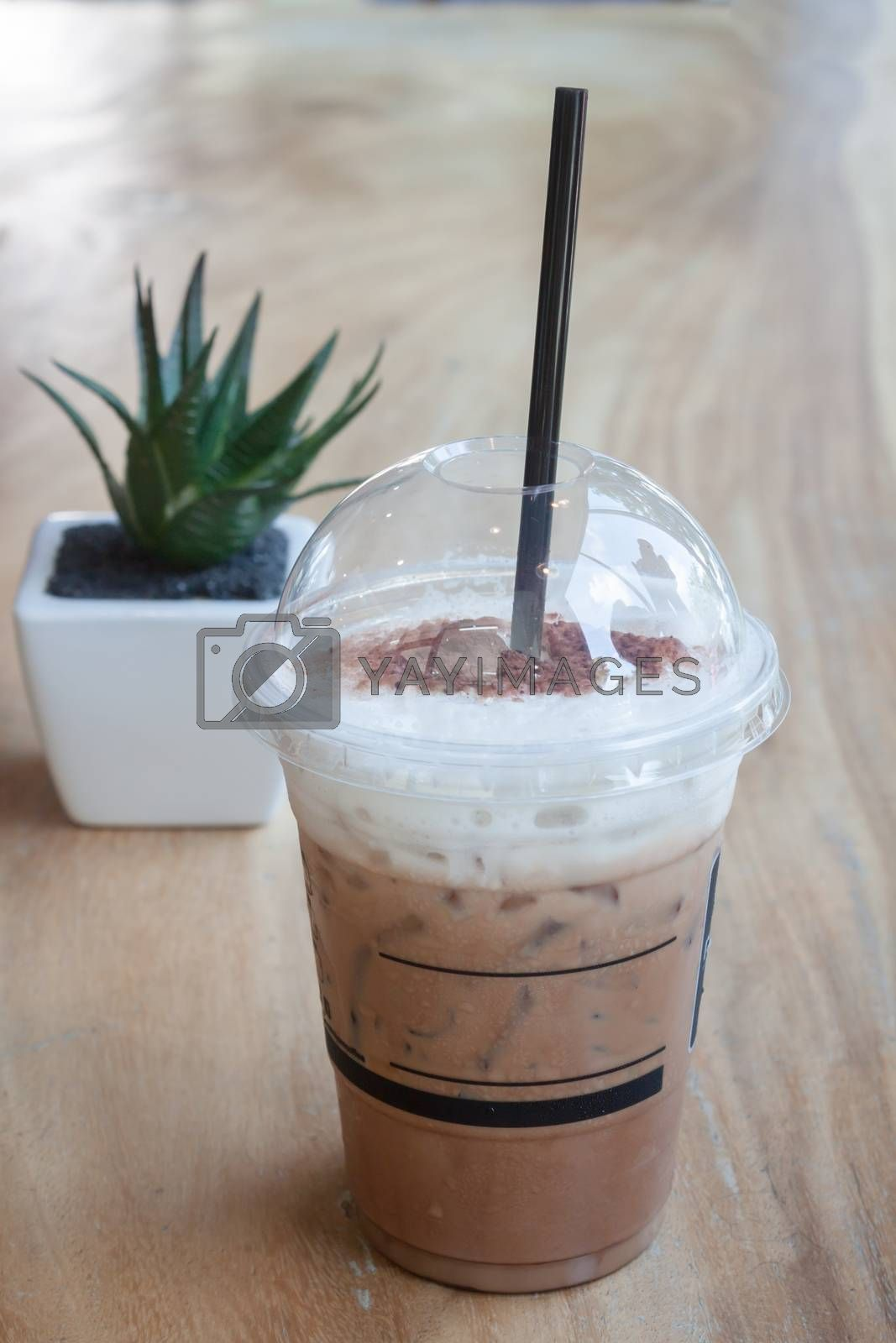 Iced coffee with green plant background, stock photo