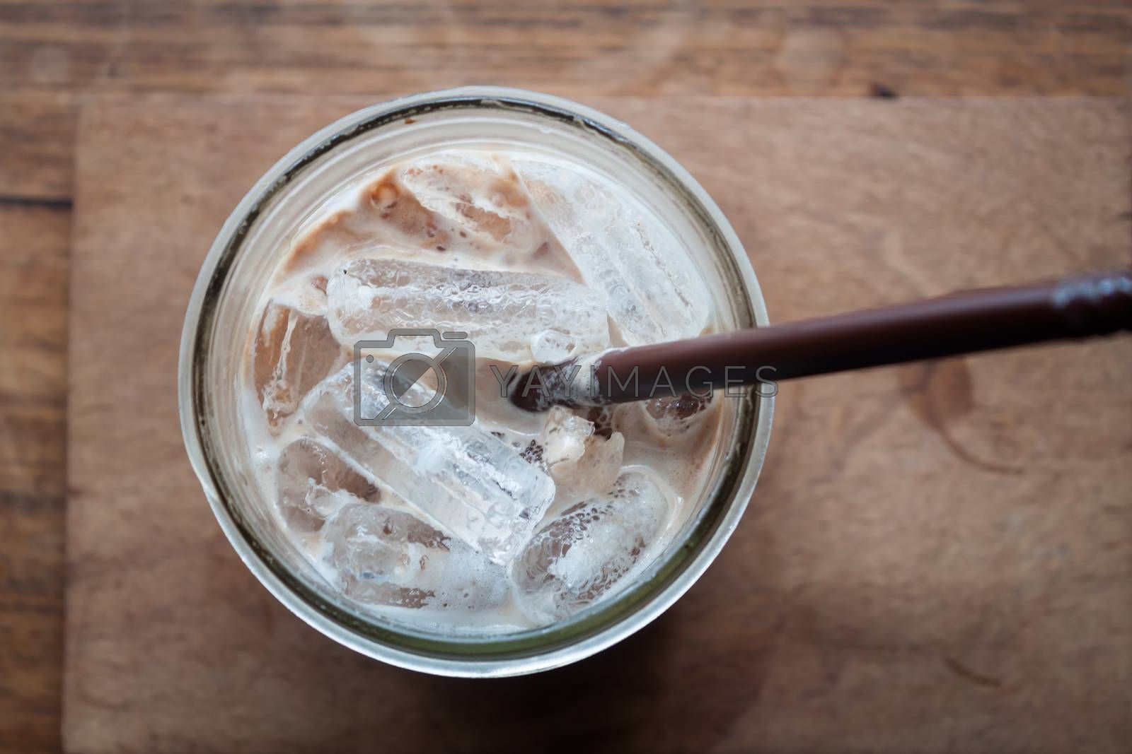 Top view of iced coffee on wooden table, stock photo