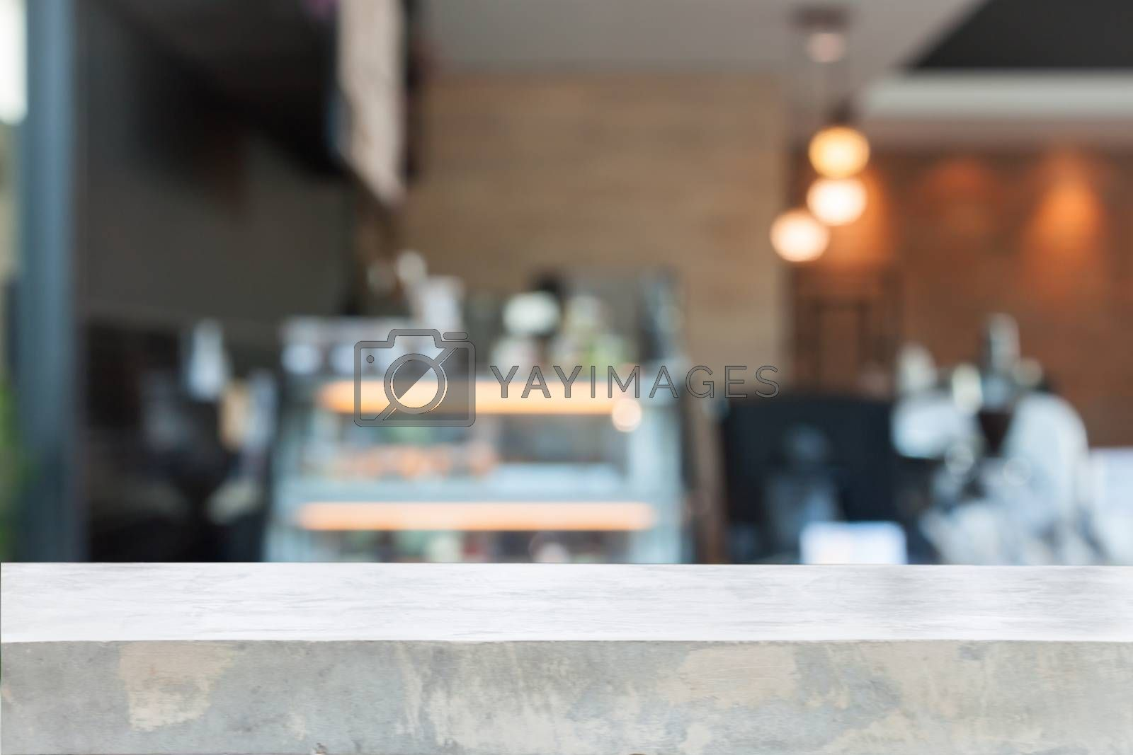 Empty concrete table top with blurred coffee shop, stock photo