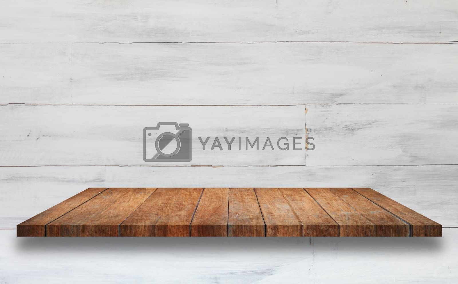 Top of brown wooden shelf with white wooden wall background. For product display