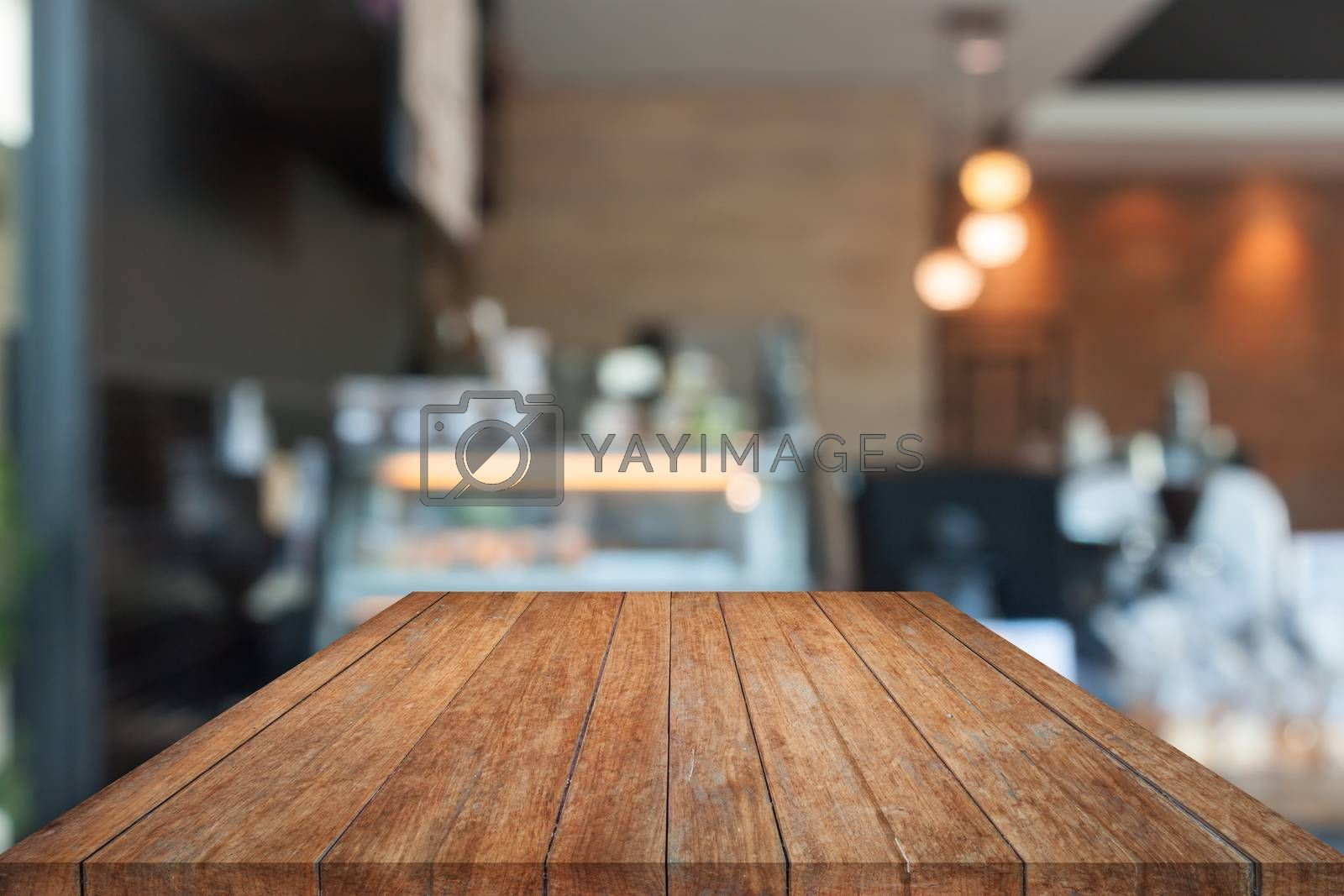 Perspective top wooden with blurred coffee shop. product display template