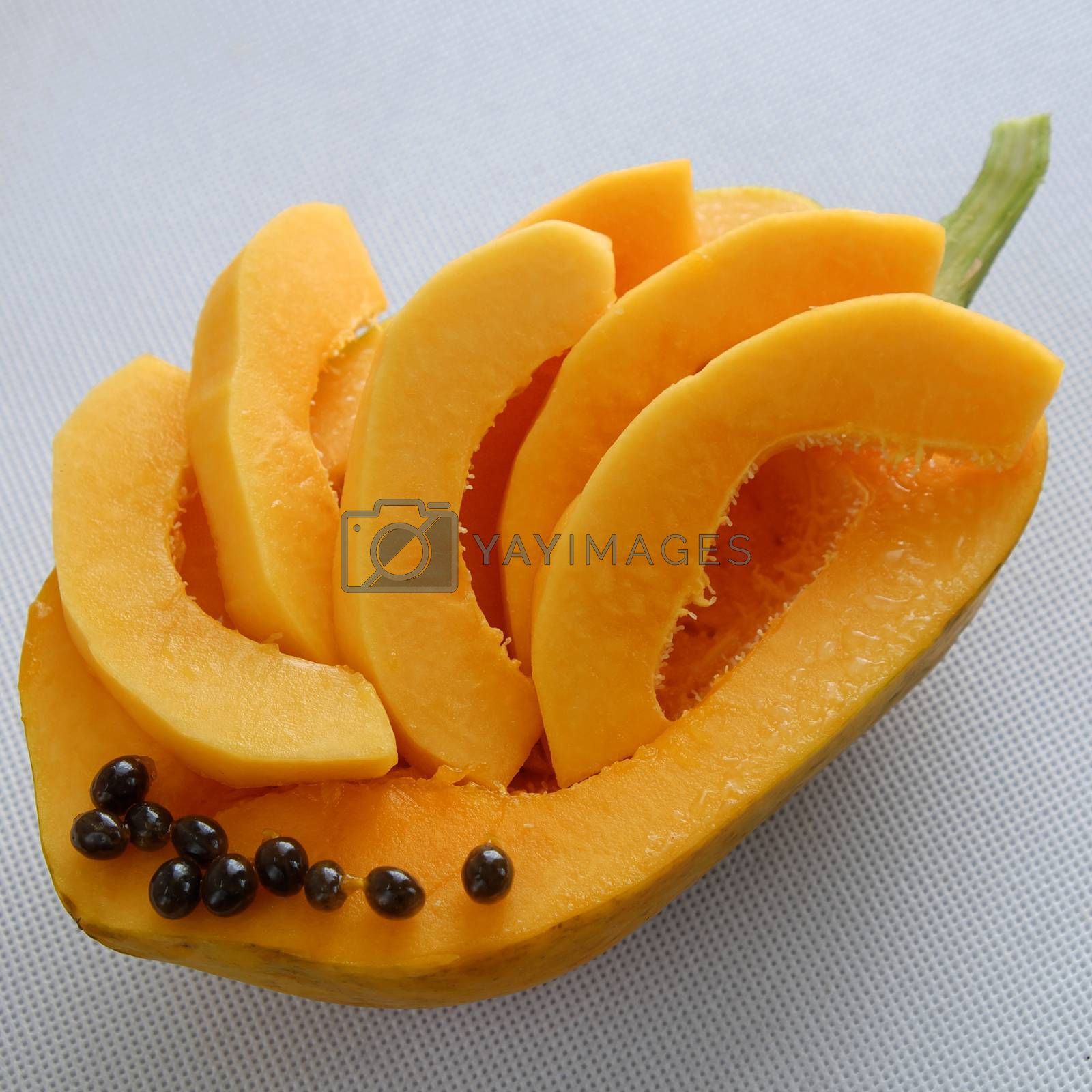 Papaya on white background, tropical fruit, Vietnamese agriculture product, rich fiber and vitamin A,C ,E, make healthy heart, prevent atherosclerosis, laxative, good for digestive system, tonic