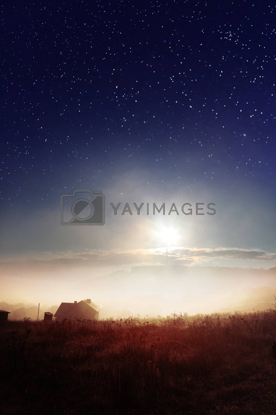 star sky with fog over countryside at autumn
