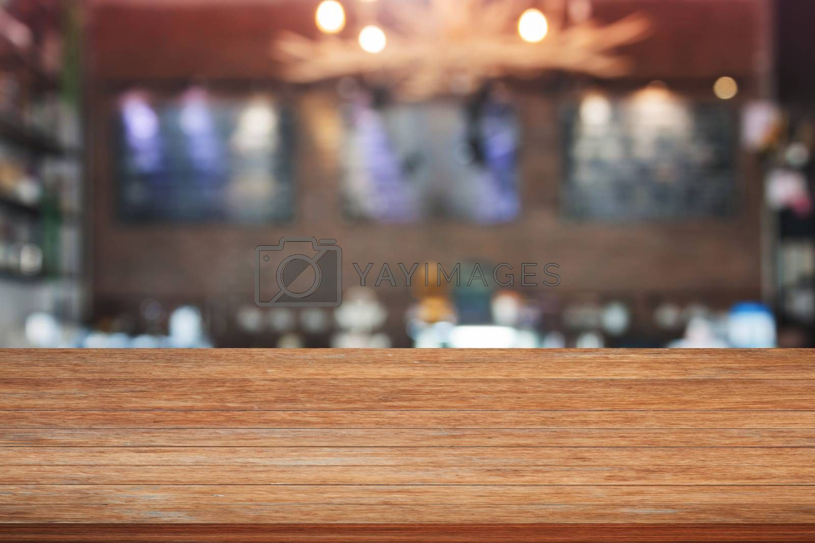Brown wooden table top with blurred cafe background. product display template